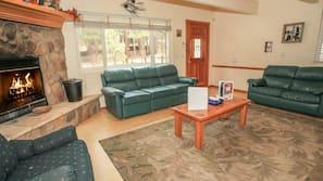 Flat-screen TV, DVD player, foosball