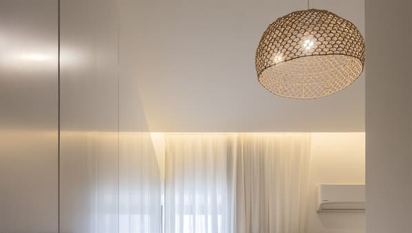 Individually furnished, blackout curtains, iron/ironing board