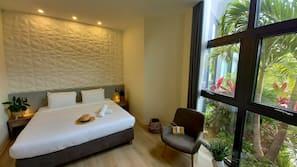 Premium bedding, laptop workspace, blackout drapes, soundproofing