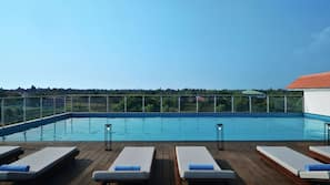 Outdoor pool, open 6:00 AM to 9:00 PM, pool umbrellas, pool loungers