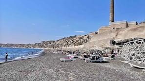 On the beach, black sand