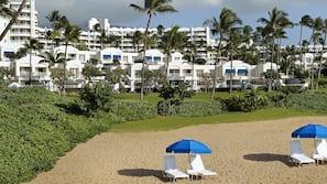 On the beach, white sand, beach cabanas, beach umbrellas