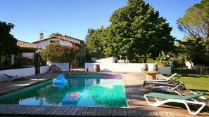 Seasonal outdoor pool, open 10:30 AM to 7:30 PM, pool umbrellas