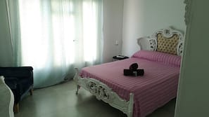 Blackout curtains, iron/ironing board, free WiFi, linens