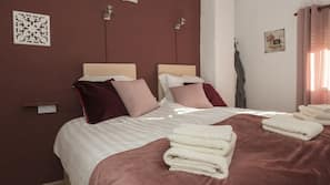 Premium bedding, minibar, blackout drapes, iron/ironing board