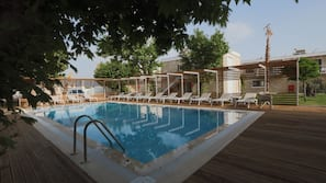 Seasonal outdoor pool, open 8:00 AM to 7:00 PM, free cabanas