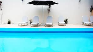 Seasonal outdoor pool, open 11:00 AM to 6:00 PM, sun loungers
