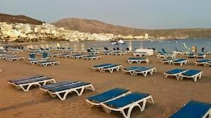 On the beach, white sand, 2 beach bars