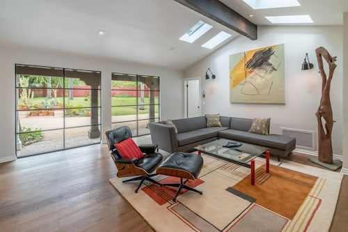Living Room, Expansive and Modern Home With Pool and Tennis Court!