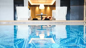 Indoor pool, open 6:00 AM to 11:00 PM, pool loungers