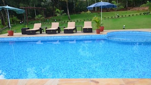 Outdoor pool, an infinity pool, open 9:00 AM to 8:00 PM, pool umbrellas
