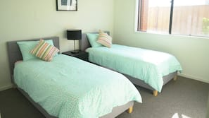4 bedrooms, blackout curtains, iron/ironing board, free WiFi