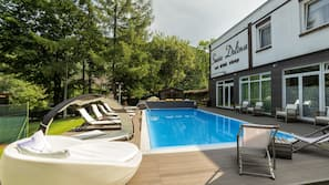 Seasonal outdoor pool, open 7:00 AM to 7:00 PM, pool umbrellas