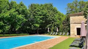 Seasonal outdoor pool, a heated pool, pool umbrellas, sun loungers