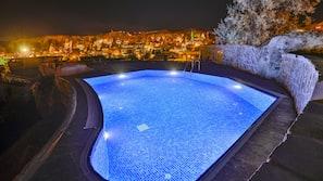 Seasonal outdoor pool, open 10:30 AM to 7:00 PM, pool umbrellas