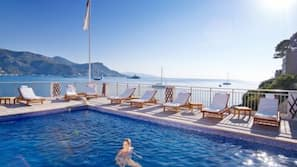 2 outdoor pools, open 9:00 AM to 7:00 PM, pool loungers