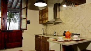 Full-size fridge, stovetop, espresso maker, coffee/tea maker