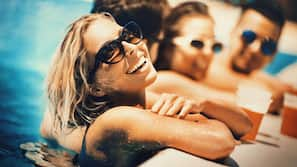4 outdoor pools, open 7:00 AM to 7:00 PM, pool umbrellas, pool loungers