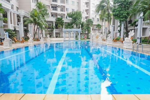 Homey 2BR at Waterplace Residence