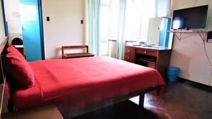In-room safe, desk, laptop workspace, bed sheets