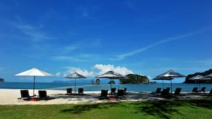 Private beach, white sand, sun-loungers, beach umbrellas