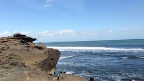 Private beach nearby, black sand