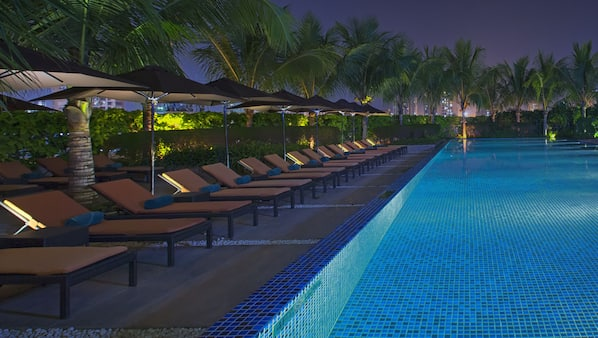 2 outdoor pools, open 7:00 AM to 10:00 PM, pool umbrellas, sun loungers