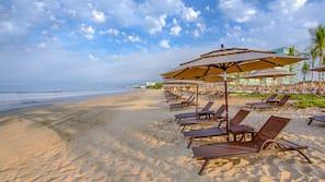 On the beach, free beach shuttle, beach cabanas, sun loungers