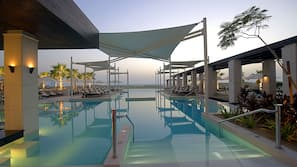Outdoor pool, open 7 AM to 9 PM, pool umbrellas