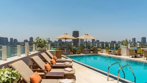 Outdoor pool, open 7:00 AM to 6:00 PM, pool umbrellas