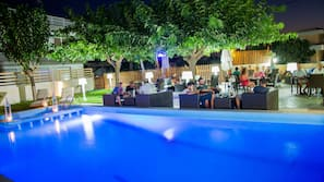 Outdoor pool, open 8:30 AM to 6 PM, pool umbrellas, pool loungers