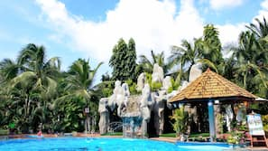Outdoor pool, open 5:00 AM to 10:00 PM, pool umbrellas, sun loungers