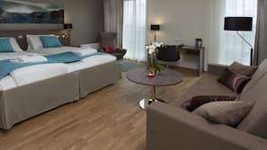 Down duvets, pillow-top beds, in-room safe, desk