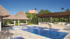 4 outdoor pools, open 8 AM to 6 PM, cabanas (surcharge), pool umbrellas