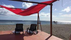 Beach nearby, black sand, 2 beach bars