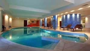 Indoor pool, 3 outdoor pools, open 7 AM to 7 AM, pool umbrellas