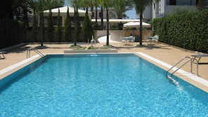Outdoor pool, open 9:30 AM to 7 PM, pool umbrellas, sun loungers