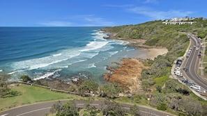 Beach nearby, white sand, beach towels, 3 beach bars