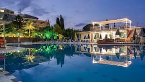2 outdoor pools, open 8:30 AM to 7 PM, pool umbrellas, pool loungers