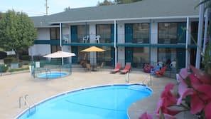 Seasonal outdoor pool, open 9:30 AM to 10:30 PM, pool umbrellas