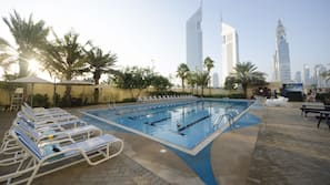 Outdoor pool, open 7:00 AM to 8:00 PM, pool umbrellas