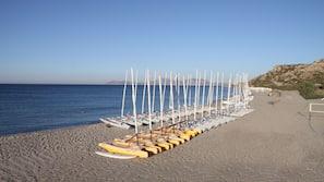 On the beach, beach towels, windsurfing, beach volleyball