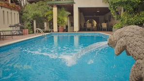 Outdoor pool, open 8 AM to 10:30 PM, sun loungers