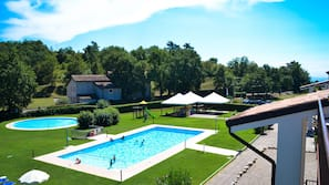 2 outdoor pools, open 8:30 AM to 8:00 PM, pool umbrellas, pool loungers