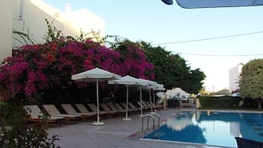 Seasonal outdoor pool, open 8:30 AM to 8:30 PM, pool umbrellas