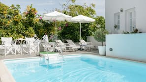 Seasonal outdoor pool, open 8:00 AM to 8:30 PM, pool umbrellas