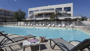Seasonal outdoor pool, open 10:00 AM to 7:00 PM, pool loungers