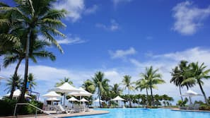3 outdoor pools, open 9 AM to 6 PM, pool umbrellas