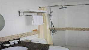 Combined shower/tub, free toiletries, hair dryer, slippers