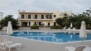 Outdoor pool, open 6 AM to 9 PM, pool umbrellas, pool loungers